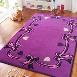 Dywan dla dzieci Smyk 16 - fioletowy kokardki